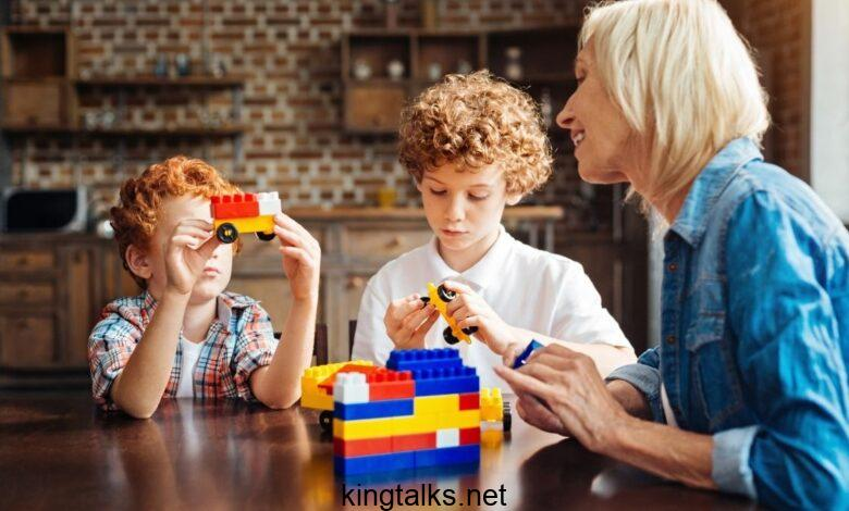 grandma with her grandkids playing with Legos
